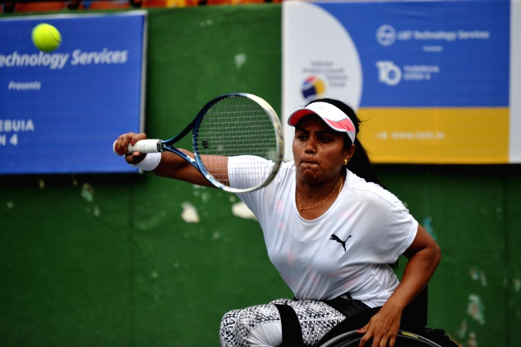 Bengaluru: Karnataka's women's single winner Prathiama Rao in the final of the wheelchair tennis tournament at the state lawn tennis court in Bengaluru's Cubbon Park on Sep 7, 2019. (Photo: IANS) - Prathiama Rao