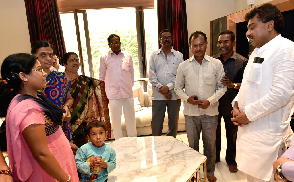 Karnataka Water Resources Minister M.B. Patil meets a group of Karnataka tourists who returned from earthquake hit Nepal at his residence in Bengaluru on April 28, 2015.