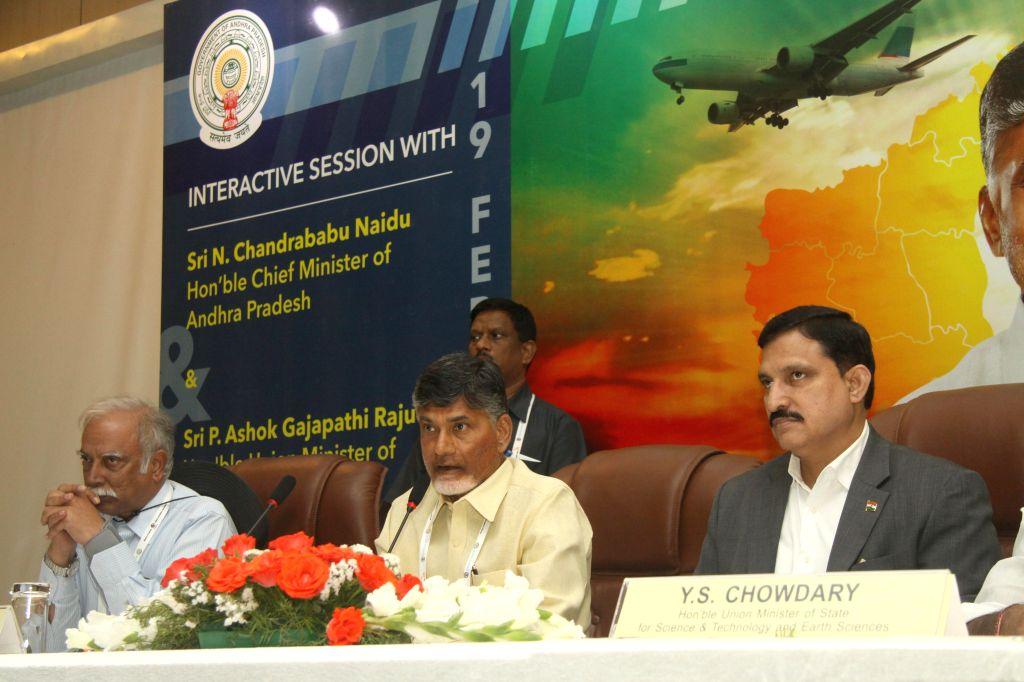 (L to R) Union Civil Aviation minister Ashok Gajapathi Raju and Andhra Pradesh Chief Minister N. Chandrababu Naidu during an interactive session organised  at the Aero India-2015 Air Show ... - Ashok Gajapathi Raju and N. Chandrababu Naidu