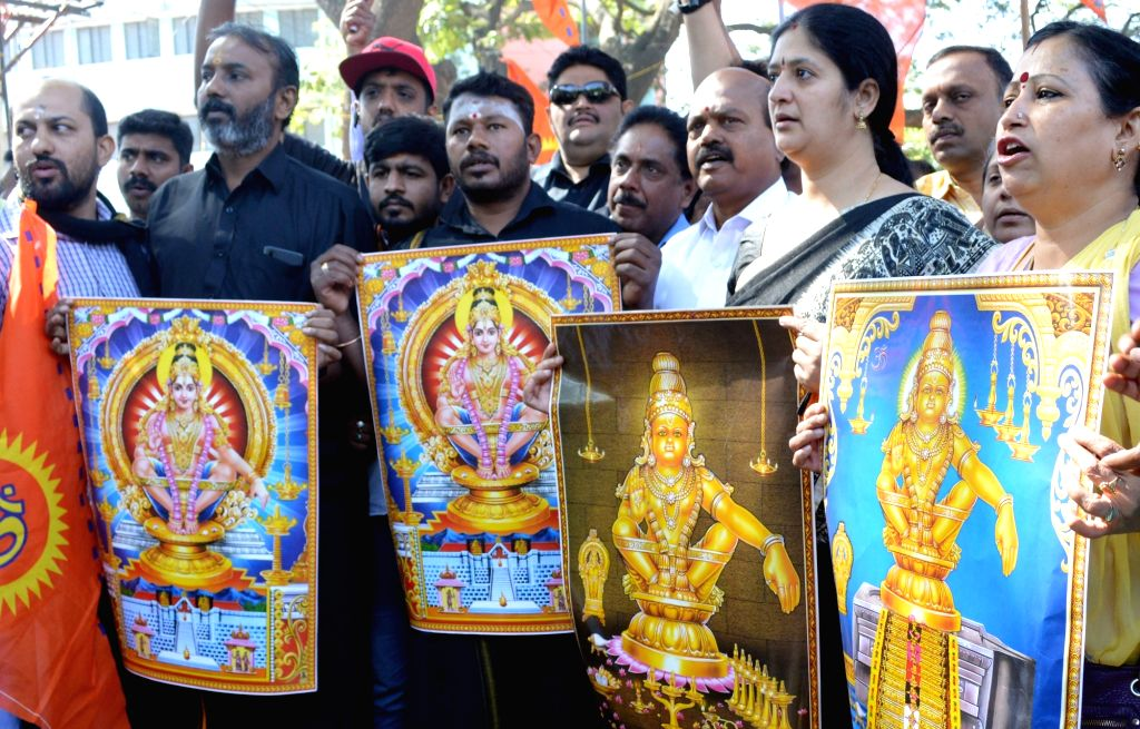 Bengaluru: Lord Ayyappa devotees stage a demonstration after two women in the hitherto banned age group entered the Sabarimala temple before dawn and offered prayers at the temple on Wednesday; in Bengaluru on Jan 3, 2019. (Photo: IANS)