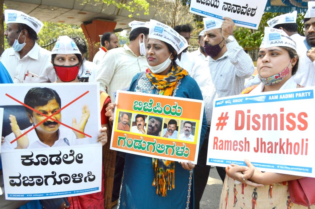 Bengaluru : Members of Aam Aadmi Party raised slogans against Minister of Water Resources of the Government of Karnataka Ramesh Jarkiholi for his alleged involvement in the CD row, in Bengaluru on ...