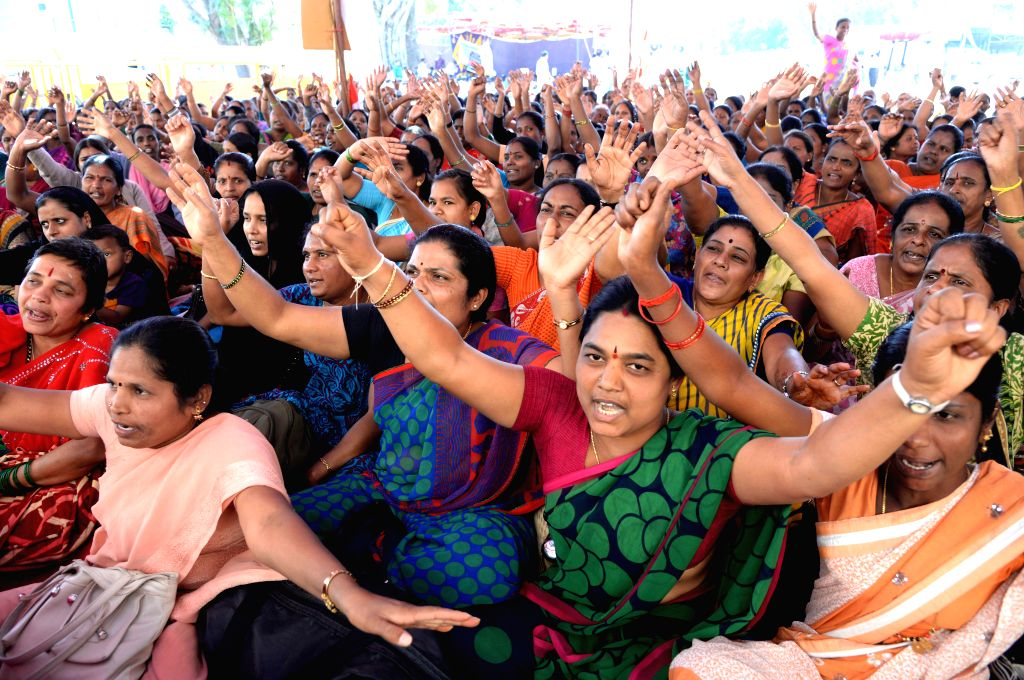 Members of Karnataka State Anganavadi Workers Association stage a demonstration to press for their various demands in Bengaluru on Feb. 4, 2015.