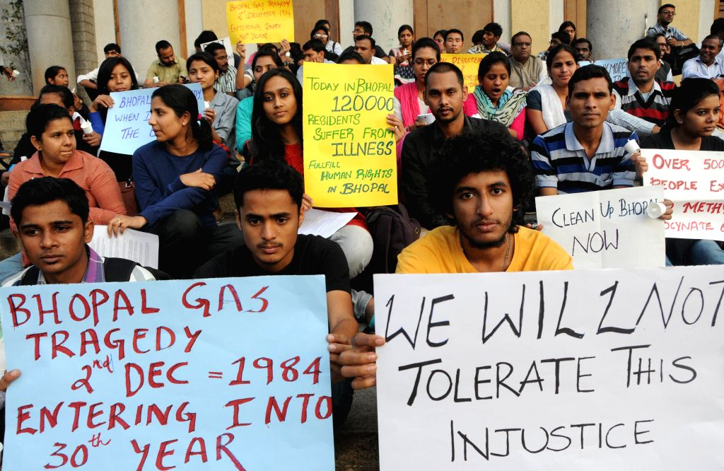 Members of the Bengaluru Solidarity Group participate in a demonstration organised on the 30th anniversary of the Bhopal gas tragedy in Bengaluru, on Dec 2, 2014.