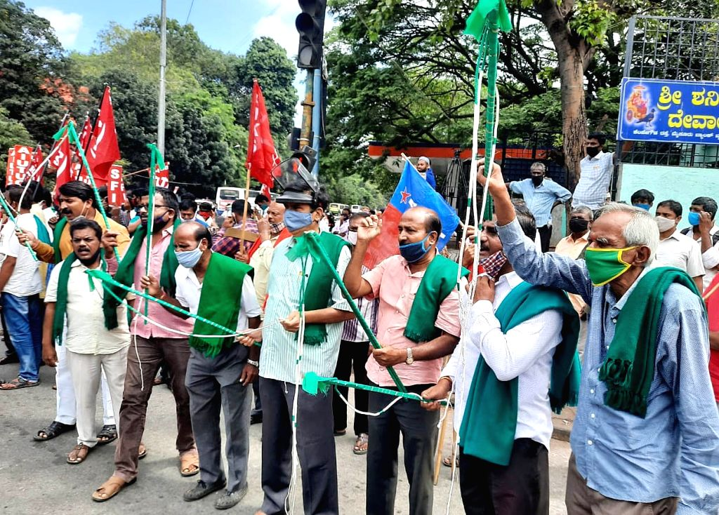 Bengaluru: Members of various farmer organisations stage a demonstration against the three contentious agriculture-related Bills that have led to agitation by farmers in many states, in Bengaluru on Sep 25, 2020. (Photo: IANS)