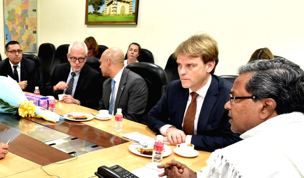Minister for citizenship and Immigration of Canada Chris Alexander during a meeting with Karnataka Chief Minister Siddaramaiah in Bengaluru on Jan. 13, 2015. - Siddaramaiah