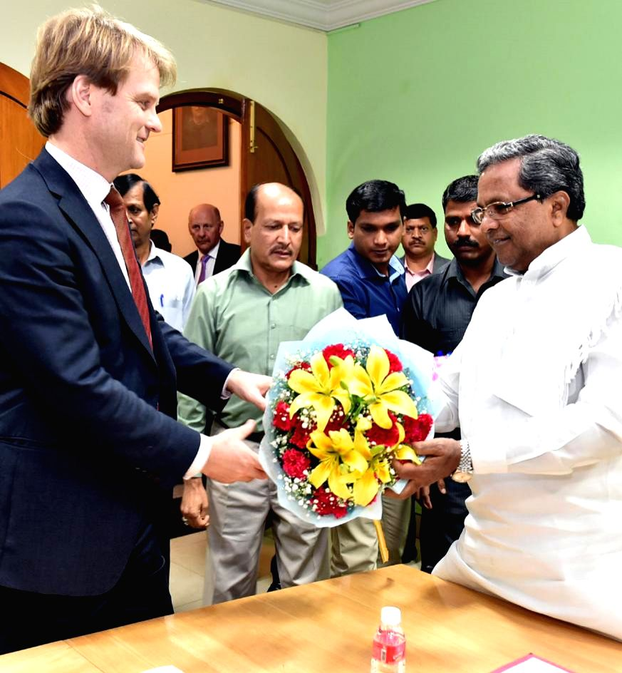 Minister for citizenship and Immigration of Canada, Chris Alexander calls on Karnataka Chief Minister Siddaramaiah in Bengaluru on Jan. 13, 2015. - Siddaramaiah