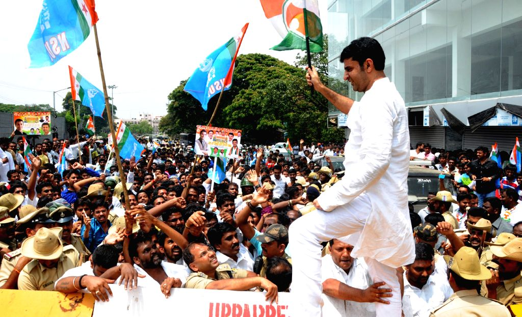 NSUI activists stage demonstration against the Narendra Modi government's land acquisition law in Bengaluru, on April 3, 2015. - Narendra Modi