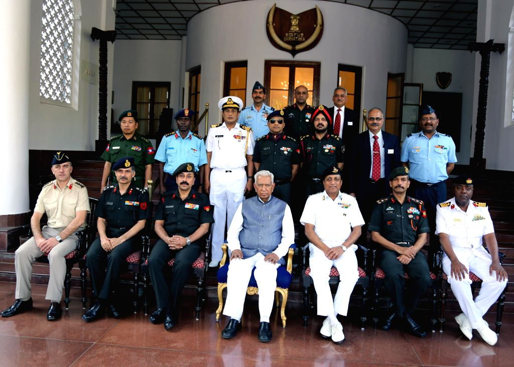 Officers from National Defence College call on Karnataka Governor Vajubhai Rudabhai Vala at Raj Bhavan, in Bengaluru, on March 9, 2015.