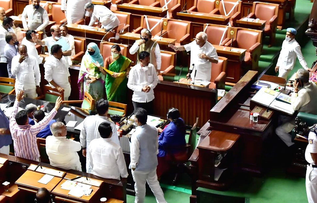 Bengaluru : Opposition party MLAs protesting during a budget session at Vidhana Soudha, in Bengaluru on Thursday 4th March 2021.