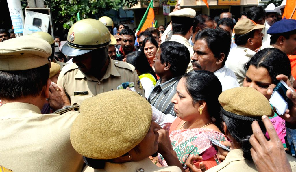 Parents of the students of a private school where a minor was allegedly raped by a teacher arrive to attend a meeting called by police in Bengaluru, on Nov 5, 2014.