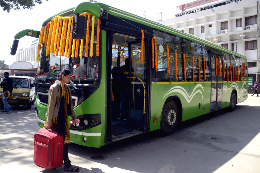 Passengers boarding the newly introduced BMTC Bus Service between Bangalore City Railway Station to KIAL Airport, at City Railway Station, in Bengaluru on Nov. 18, 2014.