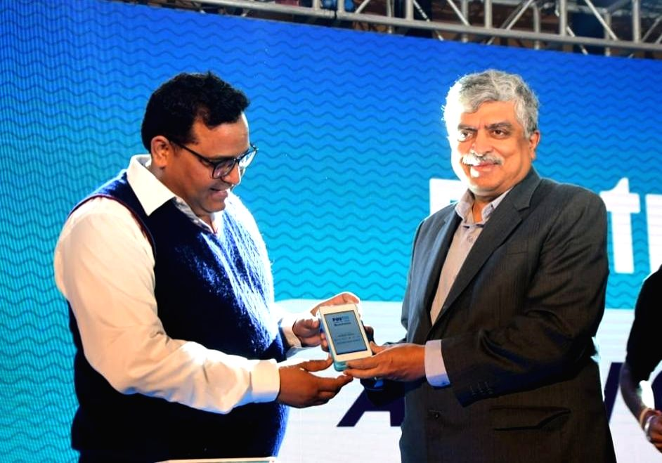 Bengaluru: Paytm Founder and CEO Vijay Shekhar Sharma and Infosys Co-Founder and Chairman Nandan Nilekani at the launch of an all-in-one payment gateway which enables digital payments through multiple methods for small and medium businesses (SME), in - Vijay Shekhar Sharma