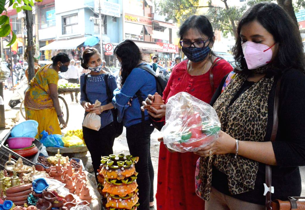 Bengaluru: People busy shopping for colourful lanterns and earthen lamps ahead of Diwali celebrations, at Gandhi Bazaar Market in Bengaluru on Nov 12, 2020. (Photo: IANS)