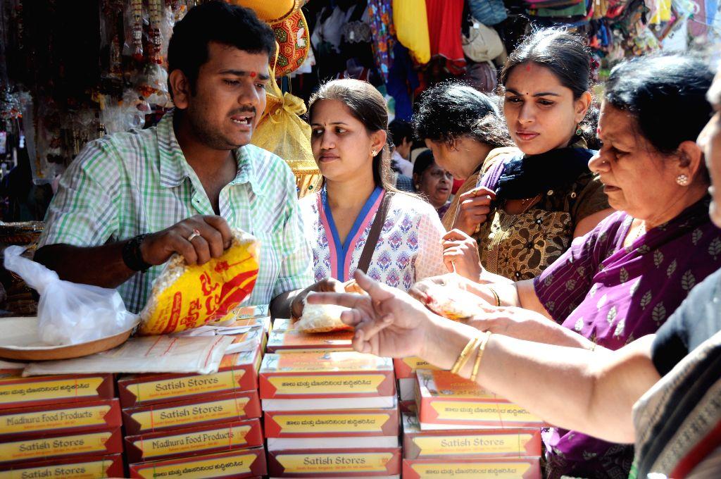 People busy with `Sankranti` (Pongal) shopping in Bengaluru, on Jan 13, 2015.