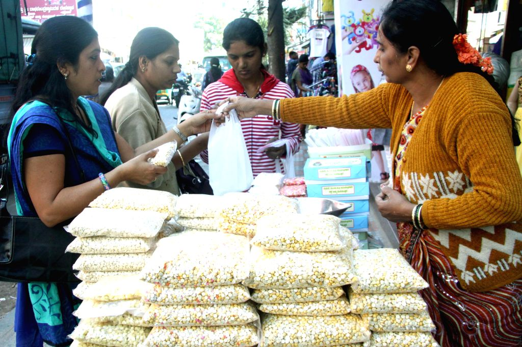 People busy with `Sankranti` (Pongal) shopping in Bengaluru, on Jan 14, 2015.