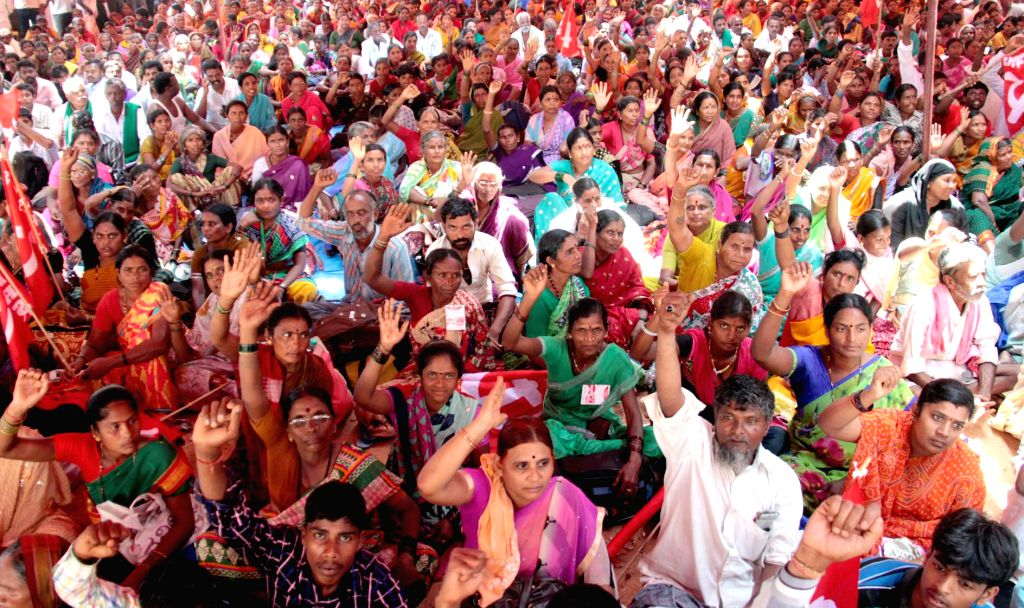 People participate in a farmers' rally against land acquisition ordinance in Bengaluru on April 28, 2015.