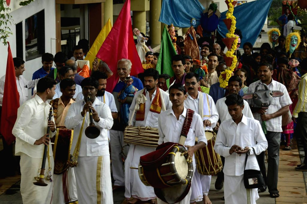 People participate in a puppet parade organised ahead of the three-day long Dhaatu International Puppet Festival,in Bengaluru on Jan 1, 2015.