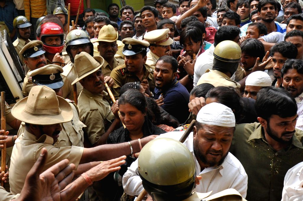 People protest against molestation of a minor by a Bangalore school teacher on Jan 7, 2015.