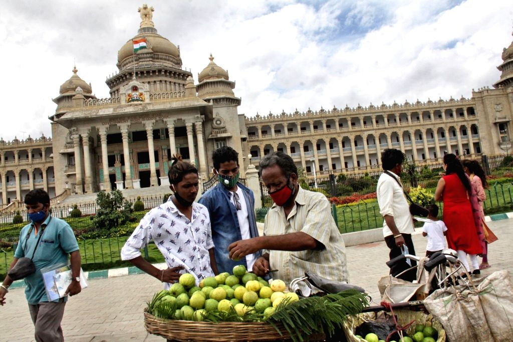 Bengaluru: People seen buying Guavas in front of the Vidhana Soudha after the State Government removed Sunday lockdowns amid COVID-19 pandemic, in Bengaluru on Aug 2, 2020. (Photo: IANS)