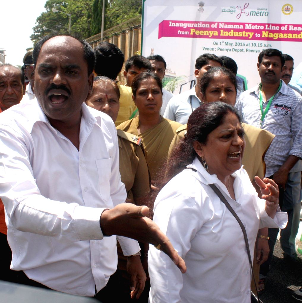 People stage a demonstration to demand basic amenities in Bengaluru on May 1, 2015. The demonstration was staged near the venue of the inauguration of Namma Metro Line.