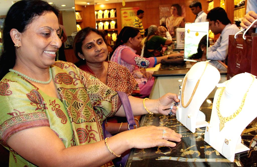 People throng a jewelery store on Akshaya Tritiya in Bengaluru, on April 21, 2015.