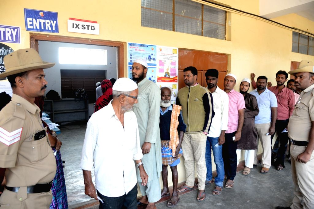 Bengaluru: People wait in the queue at Yeshwantha Pura constituency  to cast their vote for the Karnataka Assembly Bye election, in Bengaluru on Dec. 5,  2019. (Photo: IANS)