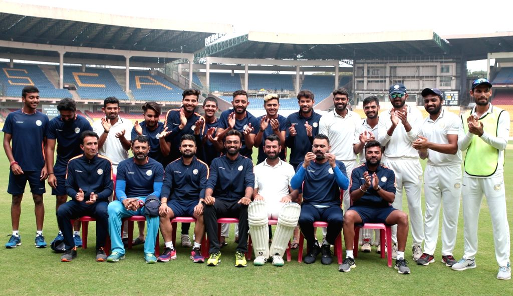 Bengaluru: Players of Saurashtra pose for a group photograph after winning the 2nd semi-final Ranji Trophy match against Karnataka at M. Chinnaswamy Stadium in Bengaluru, on Jan 28, 2019. An unbeaten 201-run partnership between Cheteshwar Pujara and