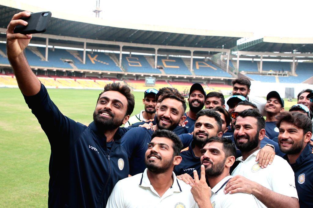 Bengaluru: Players of Saurashtra pose for selfies after winning the 2nd semi-final Ranji Trophy match against Karnataka at M. Chinnaswamy Stadium in Bengaluru, on Jan 28, 2019. An unbeaten 201-run partnership between Cheteshwar Pujara and Sheldon Jac