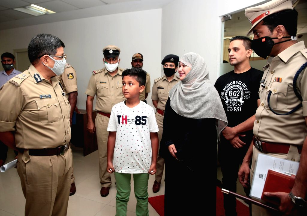 Bengaluru Police Commissioner Kamal Pant interacting with parents and their 11 year old son, who was kidnapped and the East Division police personnel arrested the kidnappers after 16 hrs operation, ...