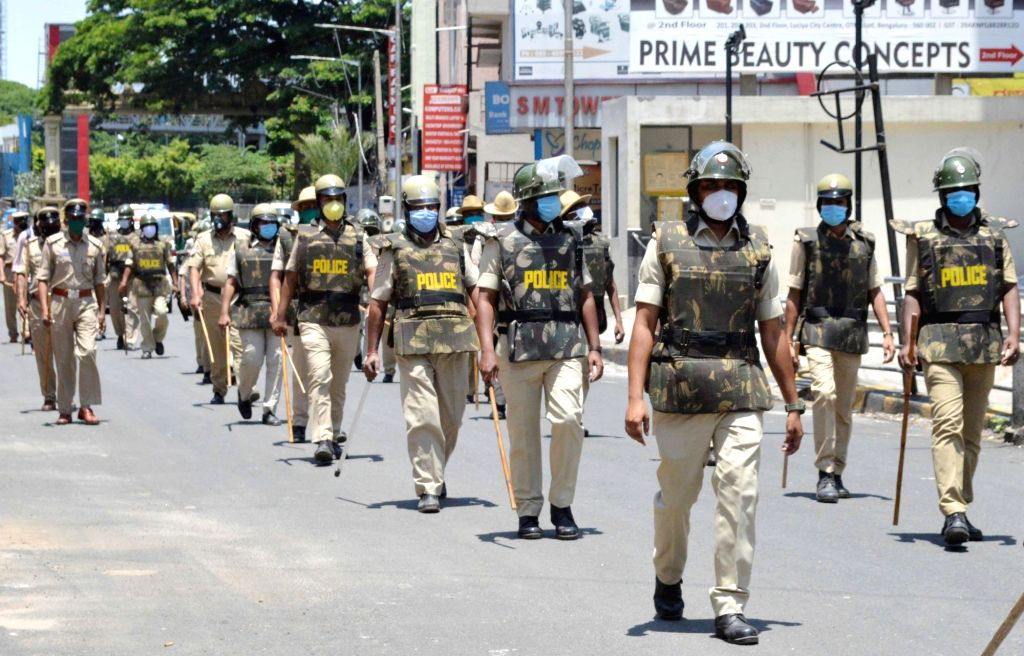 Bengaluru: Police route marches Bengaluru's JC Road during the extended nationwide lockdown imposed to mitigate the spread of coronavirus; on Apr 21, 2020. (Photo: IANS)