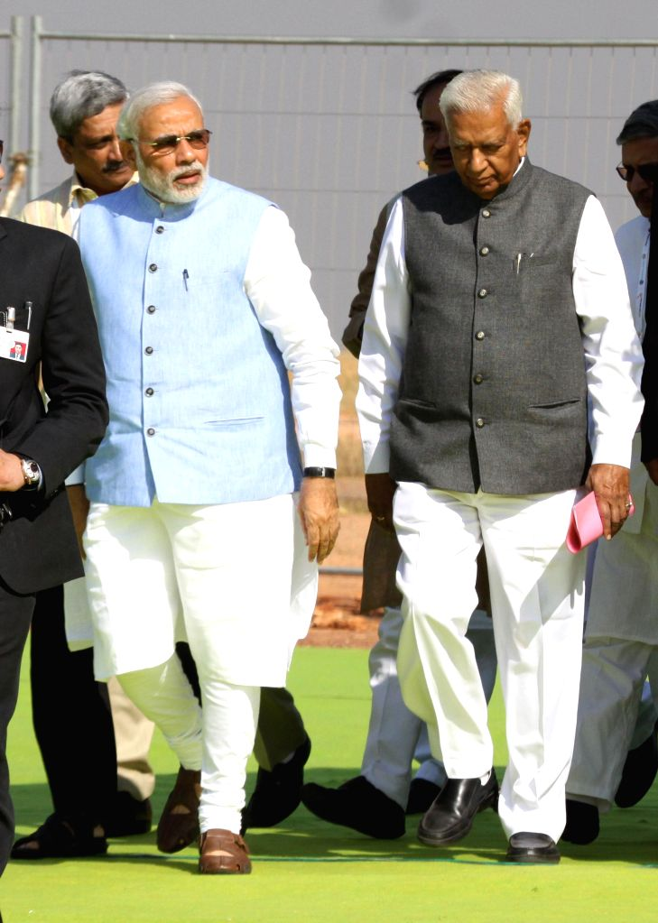 Prime Minister Narendra Modi and Karnataka Governor Vajubhai Rudabhai Vala arrive at the Aero India-2015 Air Show, at Yelahanka Air-force Station, in Bengaluru on Feb 18, 2015.​ Also ... - Narendra Modi and Ananth Kumar
