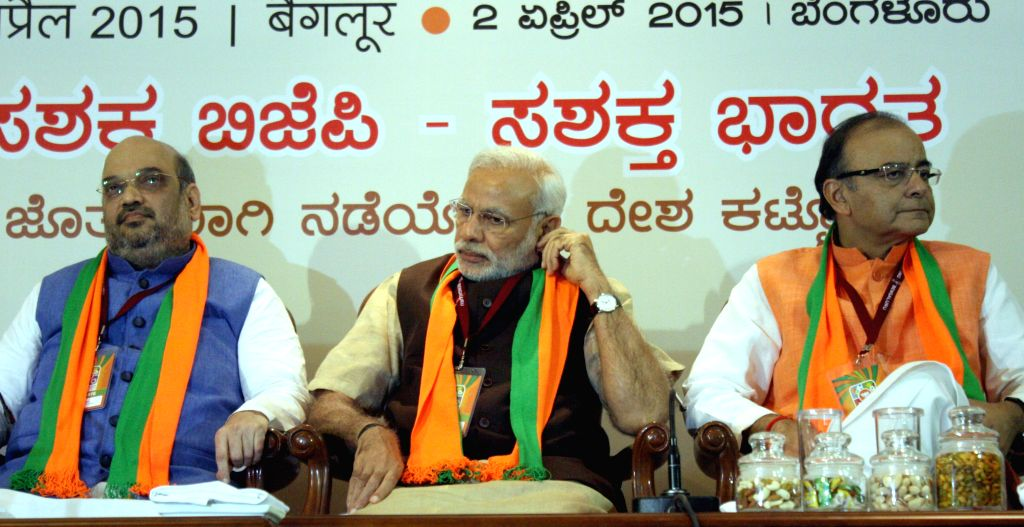 Prime Minister Narendra Modi and BJP chief Amit Shah and Union Minister for Finance, Corporate Affairs, and Information and Broadcasting Arun Jaitley during BJP National Executive ... - Narendra Modi, Amit Shah and Arun Jaitley