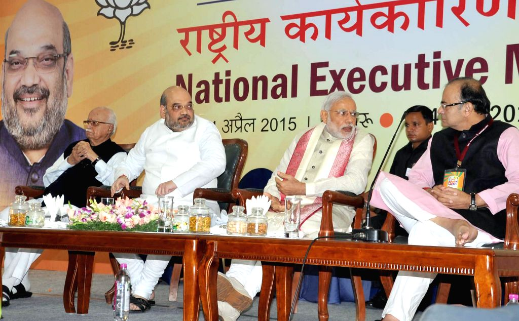 Prime Minister Narendra Modi with BJP veteran L K Advani, party chief Amit Shah and Union Minister for Finance, Corporate Affairs, and Information and Broadcasting Arun Jaitley during the ... - Narendra Modi, L K Advani, Amit Shah and Arun Jaitley