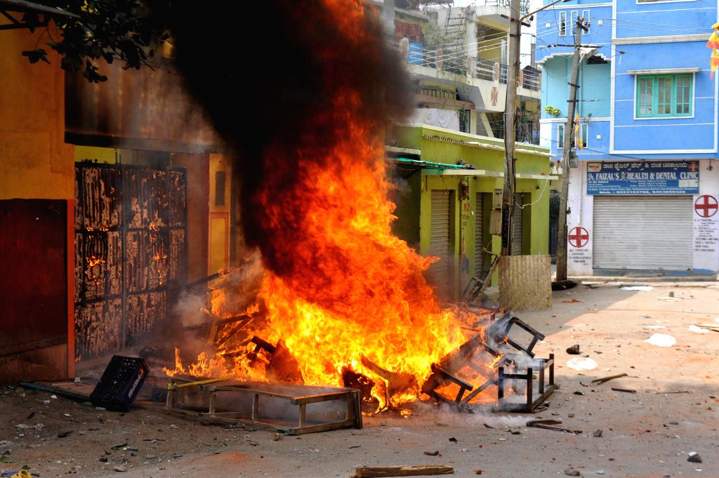 Protesters set ablaze property of a Bengaluru school where a minor was allegedly molested by a teacher on Jan 7, 2015.