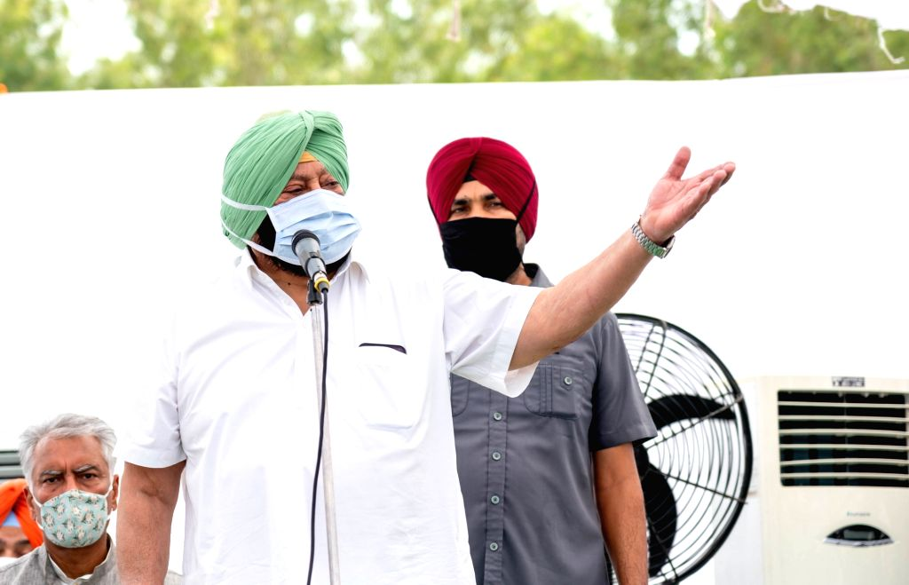 Bengaluru: Punjab Chief Minister Amarinder Singh addresses during his visit to meet the families which lost their kin in the hooch tragedy, in Tarn Taran about 25 kms from Amritsar on Aug 7, 2020. The CM announced an increased compensation of Rs 5 la - Amarinder Singh