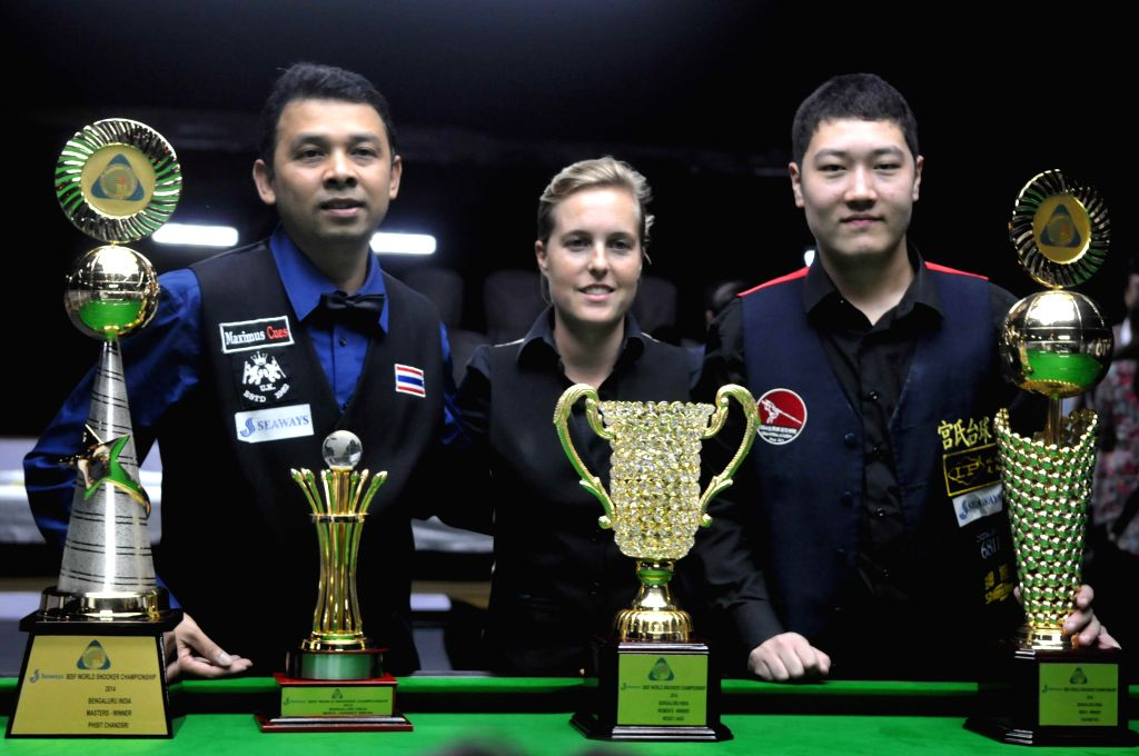 (R to L) Yan Bingtao (Mens) of China and Wendy Jans (Women) of Belgium and Pisit Chandshri (Masters) of Thailand during the prize distribution ceremony of IBSF World Snooker Championships .