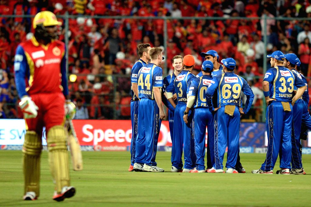 Rajasthan Royals celebrate  fall of Chris Gayle's wicket during an IPL-2015 match between Royal Challengers Bangalore and Rajasthan Royals at M Chinnaswamy Stadium in Bangaluru on April ...