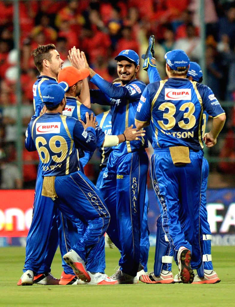 Rajasthan Royals celebrate  fall of a wicket during an IPL-2015 match between Royal Challengers Bangalore and Rajasthan Royals at M Chinnaswamy Stadium in Bangaluru on April 29, 2015.