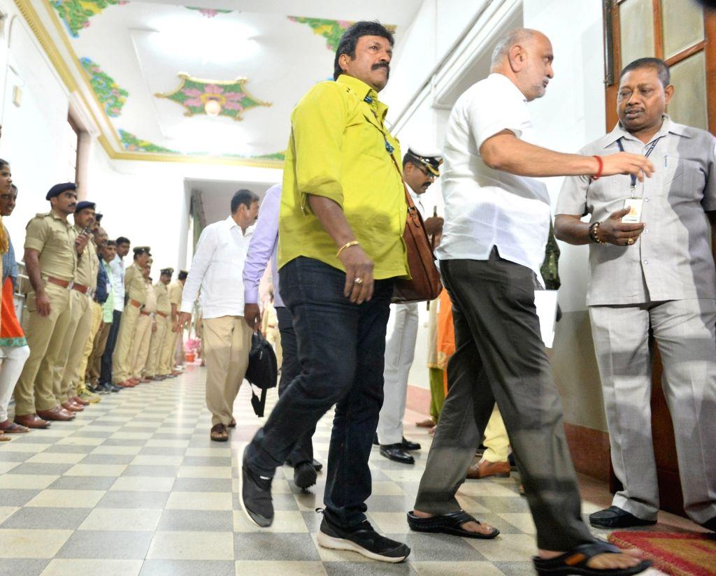 Bengaluru: Rebel Congress legislators  B.C. Patil and Shivaram Hebbar arrive at Karnataka Assembly Speaker Ramesh Kumar's chambers to submit his resignation letter in Bengaluru on July  11, 2019. (Photo: IANS) - Ramesh Kumar and C. Patil