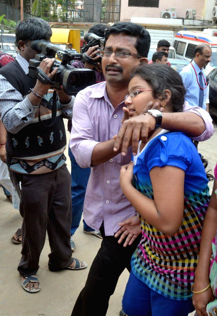 Relatives of Bhavani - who was killed in 28th Dec Church Street blast - mourn her death in Bengaluru, on Dec 29, 2014.