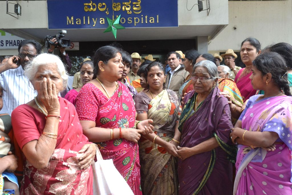 Relatives of Bhavani - who was killed in 28th Dec Church Street blast - mourn her death in Bengaluru, on Dec 29, 2014.