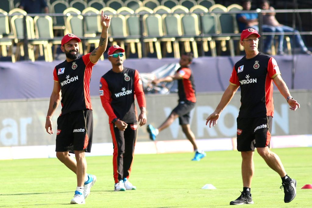 Bengaluru: Royal Challengers Bangalore (RCB) captain Virat Kohli and Head coach Gary Kirsten during a practice session at M Chinnaswamy Stadium in Bengaluru, on March 27, 2019. (Photo: IANS) - Virat Kohli