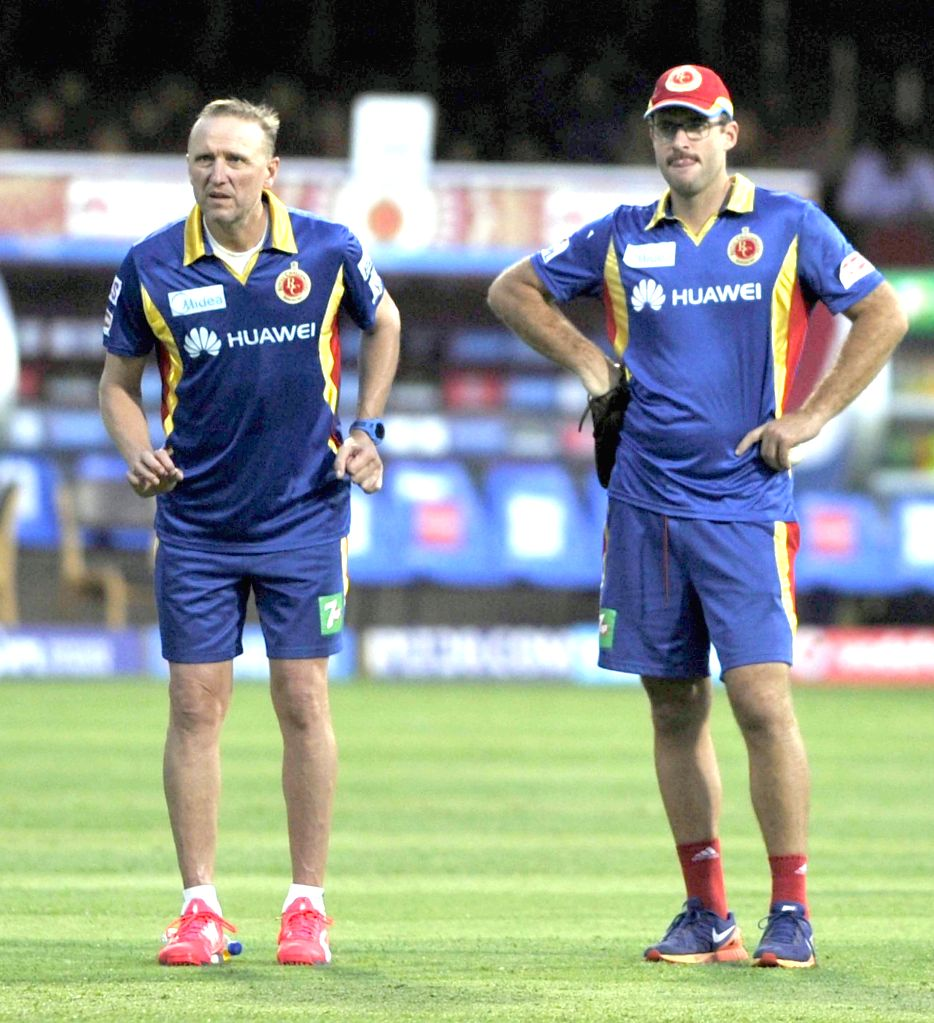 Royal Challengers Bangalore (RCB) coach Daniel Vettori and bowling coach Allan Donald during a practice session at M Chinnaswamy Stadium, in Bengaluru, on April 18, 2015.
