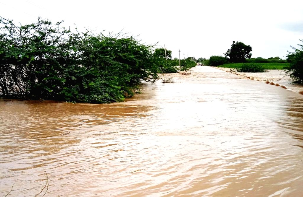 Bengaluru: School building flooded at Alur Village in Badami taluk due to heavy rainfall, at Badami in Bengaluru on Sunday, July 25, 2021. (Photo: IANS)