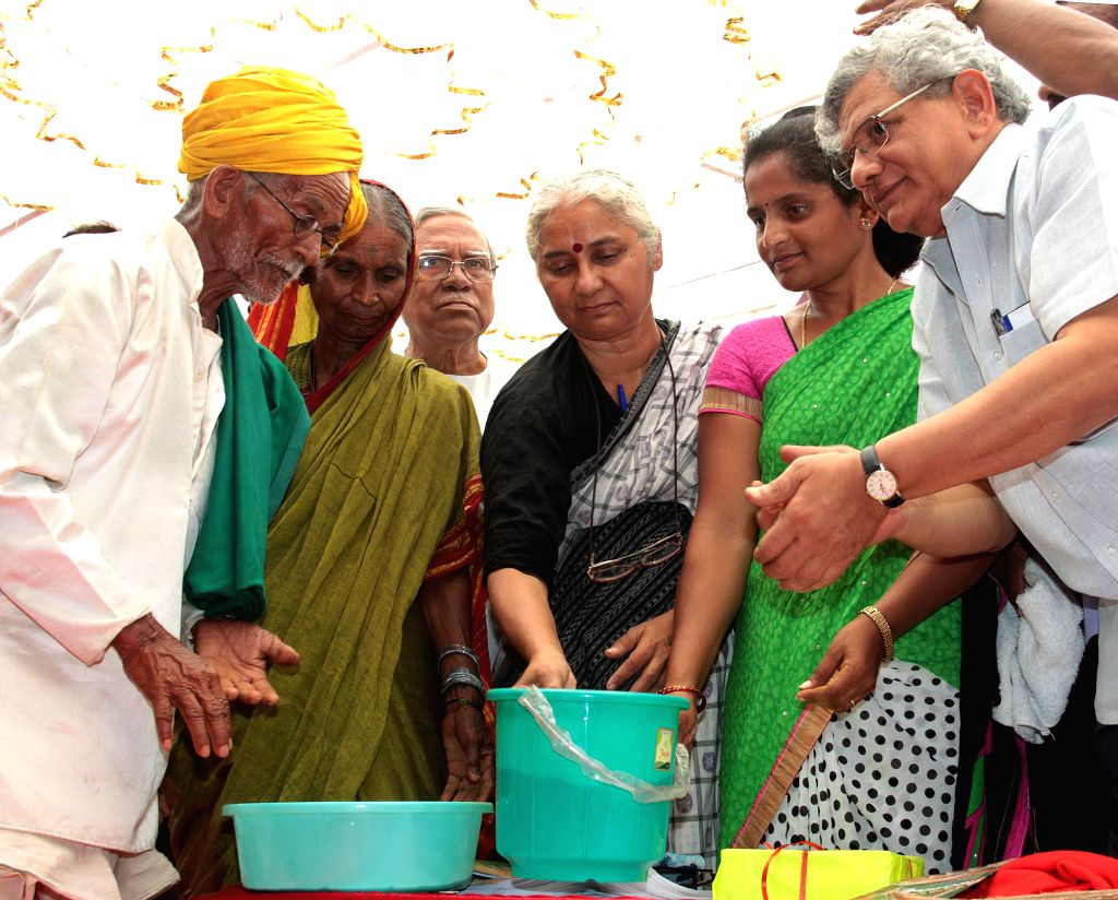 Social activist Medha Patkar and CPI-M General Secretary Sitaram Yechury during the inauguration of a farmers rally against the land acquisition ordinance in Bengaluru on April 28, 2015. - Sitaram Yechury