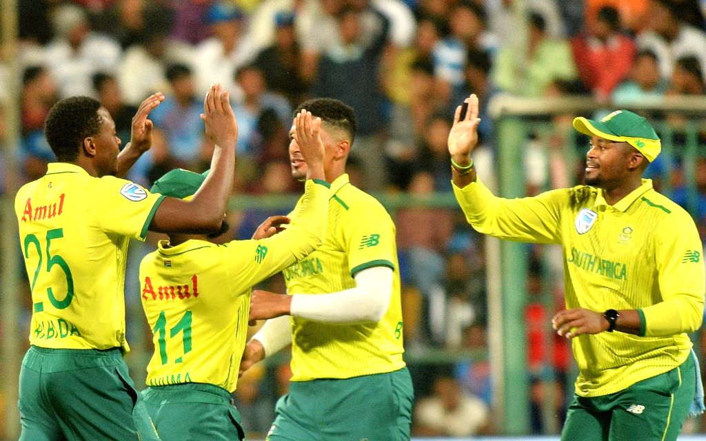 Bengaluru: South Africa's players celebrate fall of a wicket during the 3rd T20I match between India and South Africa at M. Chinnaswamy Stadium in Bengaluru on Sep 22, 2019. (Photo: IANS)