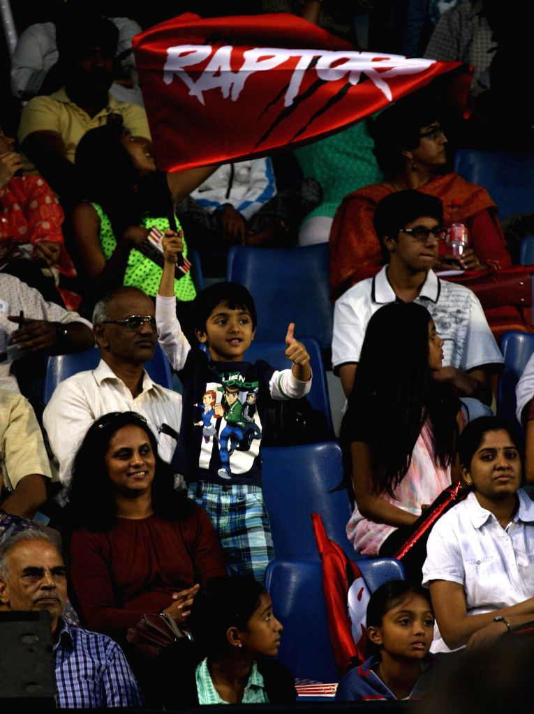 Spectators cheer during the match between Bangalore Raptors` Thomas Enqvist and Pune Marathas` Pat Cash during a Champions Tennis League match at KSLTA, in Bengaluru on Nov. 20, 2014.
