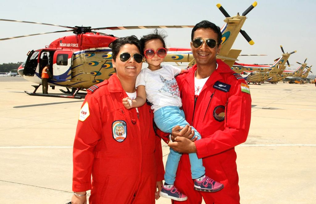 Squadron leader Deepika Misra with her husband Squadron leader Sourabh Kakkar and their daughter Aalya during Aero India Show 2015 at Yelhanka Airforce Station, in Bengaluru on Feb 20, ...