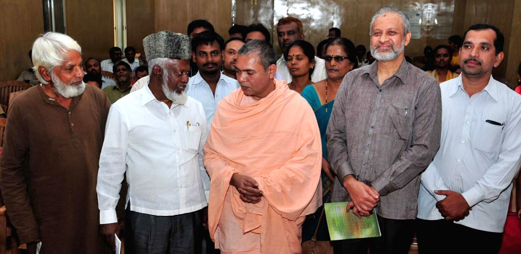 Sri Veerabhadra Chennamalla Swami of Nidumamidi Mutt with the executive director CRDDP,  Zameer Pasha, social worker Syed Safiullah, former member secretary National Minorities Commission .
