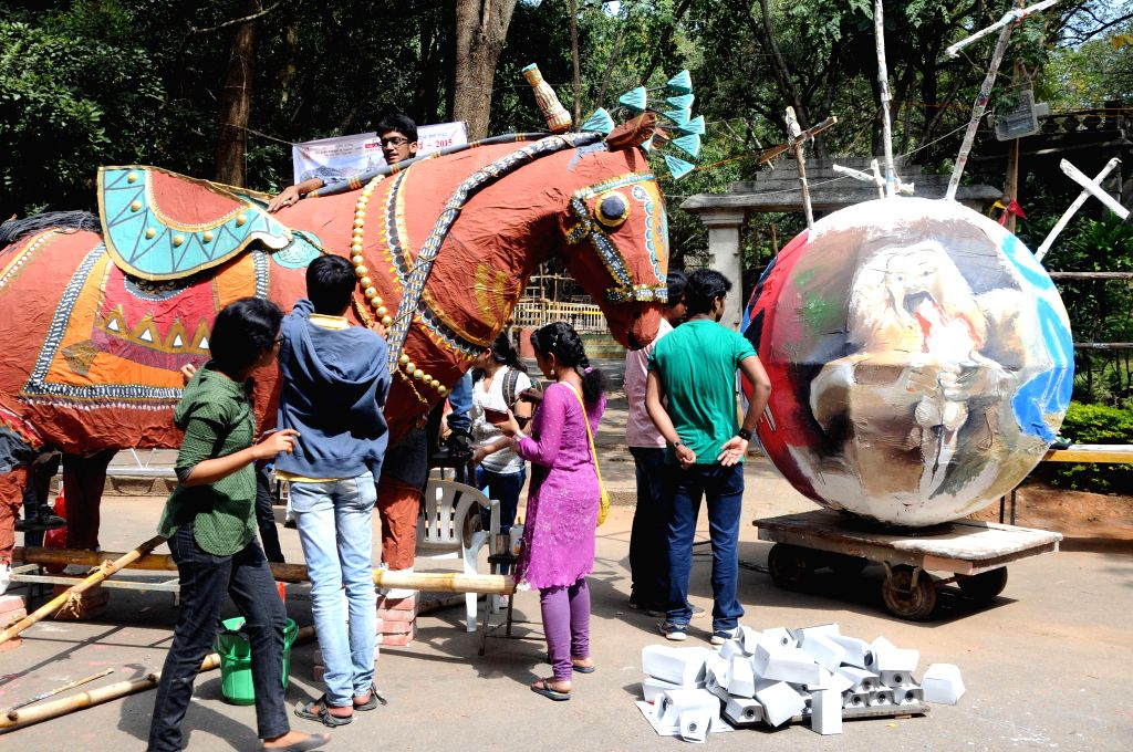 Students and artists of Chitra Kala Parishat giving final touches to the models for the Chitra Sante - 2015 organised by Karnataka Chitra Kala Parishat in Bengaluru on Jan 3, 2015.